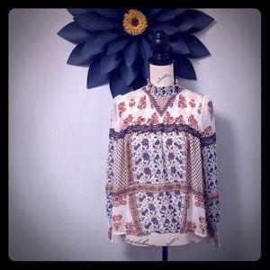 Women's XS sheer printed blouse.